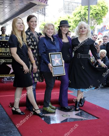 Us Band the Go-go's Charlotte Caffey (l) Belinda Carlisle (2l) Gina Schock (c) Kathy Valentine (2r) and Jane Wiedlin (r) Pose with Their Star on the Hollywood Walk of Fame During Ceremony in Hollywood California Usa 11 August 2011 the Go-go's Received the 2 444th Star on the Hollywood Walk of Fame United States Hollywood