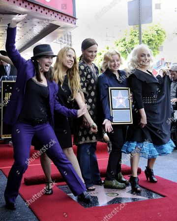 Us Band the Go-go's Kathy Valentine (l) Charlotte Caffey (2l) Belinda Carlisle (c) Gina Schock (2r) and Jane Wiedlin (r) Pose with Their Star on the Hollywood Walk of Fame During Ceremony in Hollywood California Usa 11 August 2011 the Go-go's Received the 2 444th Star on the Hollywood Walk of Fame United States Hollywood