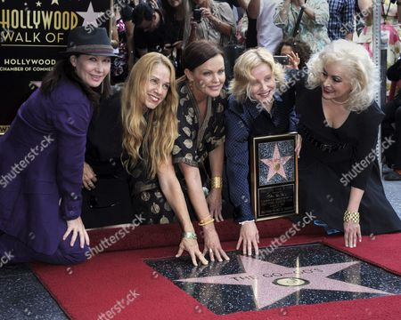 Us Band the Go-go's Kathy Valentine (l) Charlotte Caffey (2l) Belinda Carlisle (c) Gina Schock (2r) and Jane Wiedlin (r)pose with Their Star on the Hollywood Walk of Fame During Ceremony in Hollywood California Usa 11 August 2011 the Go-go's Received the 2 444th Star on the Hollywood Walk of Fame United States Hollywood