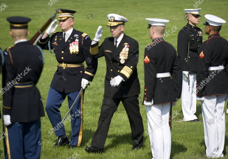 Commander of the 3rd Us Infantry Regiment Colonel David Anders (2-l) Escorts Chairman of the Joint Chiefs of Staff Admiral Mike Mullin (3-l) As He Reviews the Troops For the Last Time As Chairman During an Armed Forces Farewell Tribute and Swearing-in Ceremony in Honor of the 17th and 18th Chairman of the Joint Chiefs of Staff at Summerall Field Joint Base Myer-henderson Hall Virginia Usa 30 September 2011 Admiral Mullin is Being Succeded by Army General Martin Dempsey United States Washington