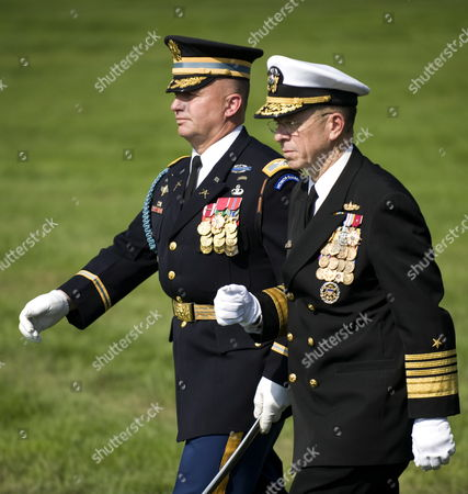 Commander of the 3rd Us Infantry Regiment Colonel David Anders Escorts Chairman of the Joint Chiefs of Staff Admiral Mike Mullin (r) As He Reviews the Troops For the Last Time As Chairman During an Armed Forces Farewell Tribute and Swearing-in Ceremony in Honor of the 17th and 18th Chairman of the Joint Chiefs of Staff at Summerall Field Joint Base Myer-henderson Hall Virginia Usa 30 September 2011 Admiral Mullin is Being Succeded by Army General Martin Dempsey United States Washington