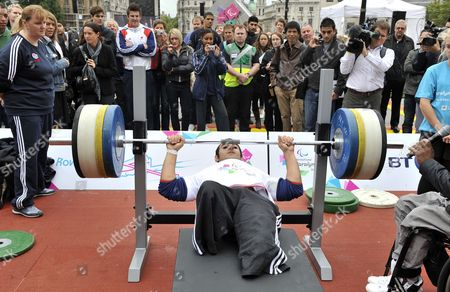 British Paralympics Powerlifter Ali Jawad 22 is Watched by Spectators As He Lifts a Weight During the International Paralympic Day 2011 at Trafalgar Square in London Britain on 08 September 2011 the Event was Held in Trafalgar Square to Promote the 2012 Paralympics Which Will Take Place in London in August 2012 United Kingdom London