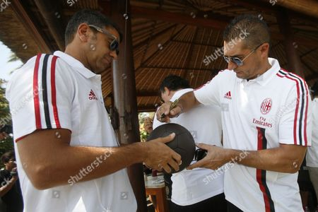 Former Soccer Player and Member of the Team 'Milan Glorie' (ac Milan's Glories) Alessandro Costacurta (l) and Daniele Massaro (r) Sign Autograph During a Press Conference in Nusa Dua Bali Indonesia 02 September 2011 Ac Milan's Glories Will Meet Indonesian All Star Legend on 4 September 2011 in a Charity Friendly Match at Gelora Bung Karno Stadium in Jakarta Indonesia Nusadua