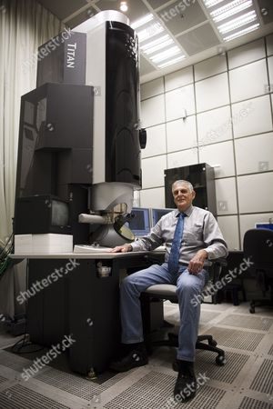 Israeli Scientist Daniel Shechtman Poses Next to a Microscope at His Laboratory in the Haifa Technion Israel on 05 October 2011 Dan Shechtman Winner of the 2011 Nobel Chemistry Prize Said 05 October That After the Royal Swedish Academy of Sciences Called to Inform Him of His Award He Told No One But His Wife But Once the Official Announcement was Made 'All Hell Broke Loose ' Shechtman a Professor at the Haifa Technion Israel Institute of Technology was Awarded the Prize For the Discovery of Quasicrystals Israel Haifa