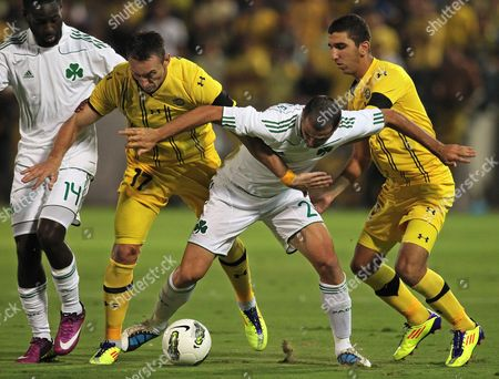 Savo Pavicevic (2nd L) and Munas Dabbur (r) of Maccabi Tel Aviv Vie For the Ball with Quincy Owusu-abeyie (l) and Loukas Vyntra (2nd R) of Panathinaikos Athens Fc During Their Uefa Europa League Play Off Soccer Match in the Bloomfield Stadium in Tel Aviv Israel 18 August 2011 Israel Tel Aviv