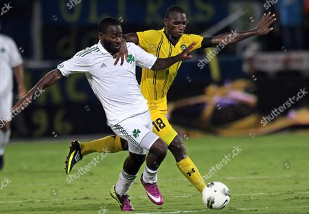 Moussa Konate (r) of Maccabi Tel Aviv Vies For the Ball with Quincy Owusu-abeyie (l) of Panathinaikos Athens Fc During Their Uefa Europa League Play Off Soccer Match in the Bloomfield Stadium in Tel Aviv Israel 18 August 2011 Israel Tel Aviv