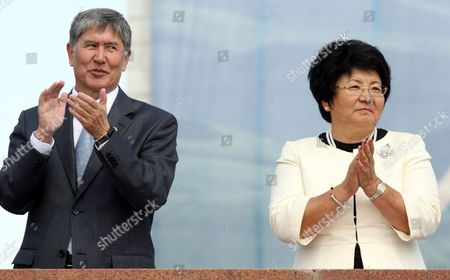 Kyrgyz President Roza Otunbayeva (r) and Kyrgyz Prime Minister Almazbek Atambayev (l) Attend a Parade on the Occasion of Kyrgyzstan's Independence Day in Bishkek Kyrgyzstan on 31 August 2011 Twenty Years Ago on the Same Day the Kyrgyz Supreme Council Accepted the Declaration on Independence of Kyrgyzstan From the Soviet Union and the Former Soviet Republic Became an Independent State the Country Celebrated the Day with Cultural Events and a Military Parade Kyrgyzstan Bishkek