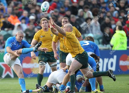 Australia's Stephen Moore (r) Tries to Charge Down a Kick From Italy's Fabio Semenzato (l) During the Rugby World Cup 2011 Match Played at North Harbour Stadium Auckland New Zealand 11 September 2011 New Zealand Auckland