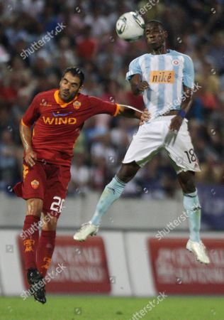 Simone Perrotta (l) of As Roma and Mamadou Bagayoko (r) of Sk Slovan Bratislava Jump For a Header During the Uefa Europa League Play Off First Leg Soccer Match Between Sk Slovan Bratislava and As Roma at the Sk Slovan Stadium in Bratislava Slovakia on 18 August 2011 Slovakia (slovak Republic) Bratislava