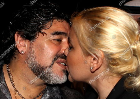 Argentinian Soccer Legend Diego Maradona (l) Kisses His Girl Friend Veronica Ojeda After Attending a Press Conference at Jumeirah Zabeel Saray Luxury Hotel in Gulf Emirate of Dubai United Arab Emirates on 11 September 2011 Maradona Talked About His New Job After He was Appointed Coach of Dubai's Al-wasl of the United Arab Emirates Domestic League United Arab Emirates Dubai