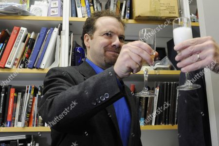 Astrophysicist Adam Riess Drinks a Glass of Sparking Wine with a Colleague After Being Awarded the 2011 Nobel Prize in Physics by the Royal Swedish Academy of Sciences in His Office at Johns Hopkins University in Baltimore Maryland Usa 04 October 2011 Riess is the the Krieger-eisenhower Professor in Physics and Astronomy and a Gilman Scholar at Johns Hopkins University He was Recognized by the Academy For His Role in the High-z Team's 1998 Discovery That the Expansion Rate of the Universe is Accelerating United States Baltimore