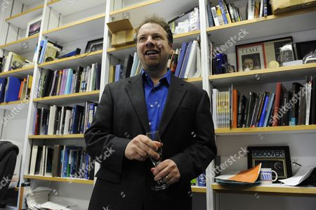 Astrophysicist Adam Riess Holds a Glass of Glass of Sparking Wine After Being Awarded the 2011 Nobel Prize in Physics by the Royal Swedish Academy of Sciences in His Office at Johns Hopkins University in Baltimore Maryland Usa 04 October 2011 Riess is the the Krieger-eisenhower Professor in Physics and Astronomy and a Gilman Scholar at Johns Hopkins University He was Recognized by the Academy For His Role in the High-z Team's 1998 Discovery That the Expansion Rate of the Universe is Accelerating United States Baltimore
