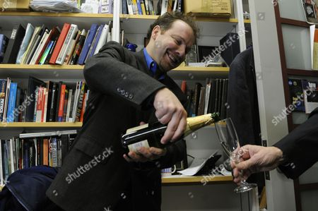 Astrophysicist Adam Riess Pours a Glass of Sparking Wine with a Colleague After Being Awarded the 2011 Nobel Prize in Physics by the Royal Swedish Academy of Sciences in His Office at Johns Hopkins University in Baltimore Maryland Usa 04 October 2011 Riess is the the Krieger-eisenhower Professor in Physics and Astronomy and a Gilman Scholar at Johns Hopkins University He was Recognized by the Academy For His Role in the High-z Team's 1998 Discovery That the Expansion Rate of the Universe is Accelerating United States Baltimore
