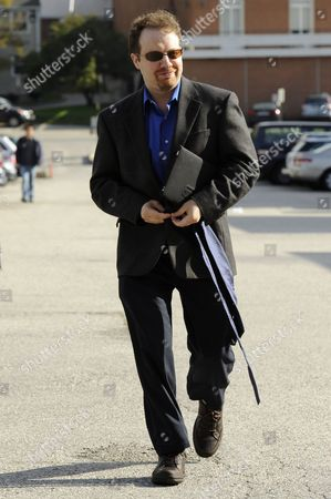 Astrophysicist Adam Riess Buttons His Coat While Walking to His Office After Being Awarded the 2011 Nobel Prize in Physics by the Royal Swedish Academy of Sciences at Johns Hopkins University in Baltimore Maryland Usa 04 October 2011 Riess is the the Krieger-eisenhower Professor in Physics and Astronomy and a Gilman Scholar at Johns Hopkins University He was Recognized by the Academy For His Role in the High-z Team's 1998 Discovery That the Expansion Rate of the Universe is Accelerating United States Baltimore