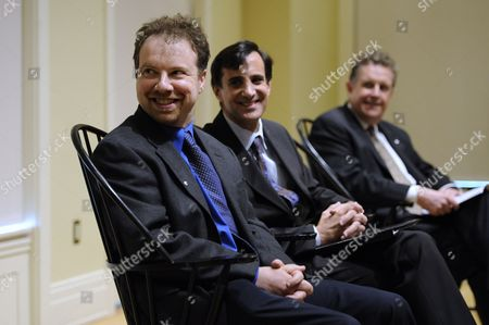 Stock Picture of Astrophysicist Adam Riess (l) Sits with Johns Hopkins University President Ronald Daniels (c) and Director of the Space Telescope Science Institute Matt Mountain (r) During a News Conference After Riess was Awarded the 2011 Nobel Prize in Physics by the Royal Swedish Academy of Sciences at Johns Hopkins University in Baltimore Maryland Usa 04 October 2011 Riess is the the Krieger-eisenhower Professor in Physics and Astronomy and a Gilman Scholar at Johns Hopkins University He was Recognized by the Academy For His Role in the High-z Team's 1998 Discovery That the Expansion Rate of the Universe is Accelerating United States Baltimore