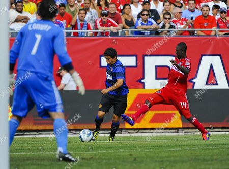 Chicago Fire Midfielder Patrick Nyarko (r) Attempts to Block a Shot For a Goal by Manchester United Defender Rafael Ds Silva (c) As Chicago Fire Goal Keeper Jon Conway (l) Watches in the Second Half of the Herbalife World Football Challenge 2011 at Soldier Field in Chicago Illinois Usa 23 July 2011 Manchester United Defeated the Chicago Fire 3-1 United States Chicago