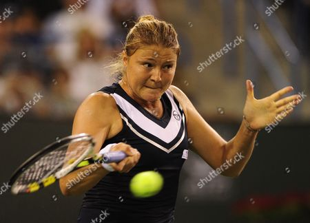 Dinara Safina of Russia Hits a Forehand Against Maria Sharapova of Russia at the Bnp Paribas Open in Indian Wells California Usa 15 March 2011 United States Indian Wells