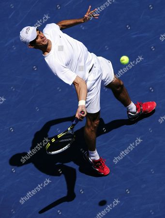 Stock Picture of Rogerio Dutra Da Silva of Brazil who Replaced Robin Soderling of Sweden who Withrew Due to Sickness Hits a Return to Louk Sorensen of Ireland During Their First Round Match on the Third Day of the 2011 Us Open Tennis Championship at the Usta National Tennis Center in Flushing Meadows New York Usa 31 August 2011 the Us Open Runs Through 11 September 2011 Epa/john G Mabanglo United States Flushing Meadows
