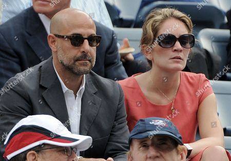 Us Actor Stanley Tucci (l) and an Unidentified Companion Watch As Novak Djokovic of Serbia Plays Roger Federer of Switzerland During Their Semifinal Round Match on the Thirteenth Day of the 2011 Us Open Tennis Championship at the Usta National Tennis Center in Flushing Meadows New York Usa 10 September 2011 the Us Open Has Been Extended Due to Weather For the Fourth Year in a Row and the Men's Final Will Now Be Played on 12 September 2011 United States Flushing Meadows