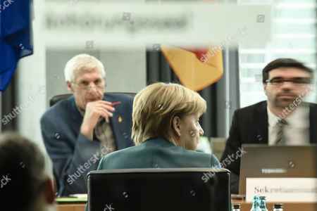 German Chancellor Angela Merkel (C) attends a parliamentary commission investigating the diesel emissions scandal involving German carmaker Volkswagen (VW), in Berlin, Germany, 08 March 2017. New evidence suggests that former CEO of VW, Martin Winterkorn knew earlier than he claims about fraudulent emission tests in Volkswagen vehicles.