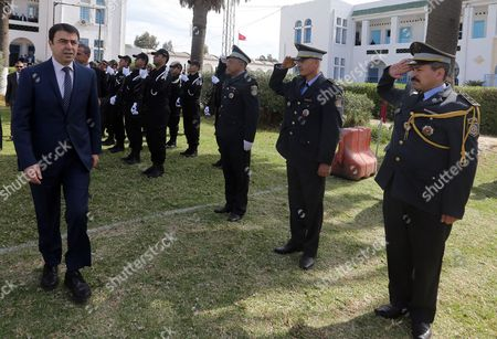 Tunisian Interior Minister Hedi Majdoub (l) Inspects a Guard of Honor As He Arrives at Ceremony of the 60th Anniversary of the Tunisian Police at Bouchoucha Police Barracks Tunis Tunisia 14 April 2016 the Tunisian Police Force was Estibalished on 18 April 1956 After Tunisia Gained Its Independence From France Tunisia Tunis
