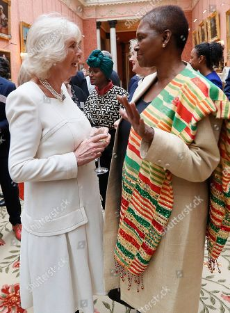 Britain's Camilla, the Duchess of Cornwall, left, speaks to Baroness Amos as she hosts a Women of the World reception at Buckingham Palace in London