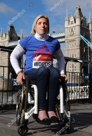 Stock Photo of Women's Elite Wheelchair Athlete Britain's Shelly Woods Poses in Front of Tower Bridge During a London Marathon Photocall Ahead of the London Marathon in London Britain 19 April 2013 the London Marathon Takes Place on 21 April United Kingdom London