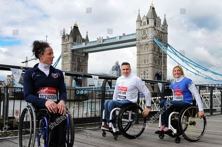 Winner of the Women's Elite Wheelchair Boston Marathon American Athlete Tatyana Mcfadden (l) with Britain's David Weir (c) and Britain's Shelly Woods (r) Pose in Front of Tower Bridge During a London Marathon Photocall Ahead of the London Marathon in London Britain 19 April 2013 the London Marathon Takes Place on 21 April United Kingdom London