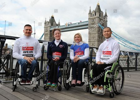 Elite Wheelchair Marathon Athletes (l-r) Britain's David Weir Tatyana Mcfadden of the Usa Britain's Shelly Woods and Japan's Hiroyuki Yamamoto Pose in Front of Tower Bridge During a London Marathon Photocall Ahead of the London Marathon in London Britain 19 April 2013 the London Marathon Takes Place on 21 April United Kingdom London