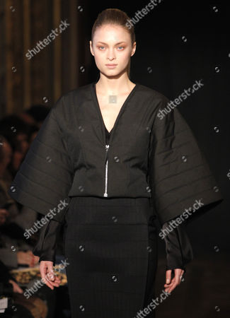 Stock Photo of A Model Presents a Creation by Dutch Designer Steffie Christiaens During the Paris Fashion Week in Paris France 26 February 2013 the Presentation of the Ready to Wear Collections Fall / Winter 2013-2014 Runs From 26 February to 03 March France Paris