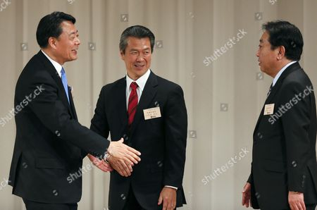 Former Trade Minister Banri Kaieda (l) Reaches His Hands to Prime Minister Yoshihiko Noda (r) As His Contender Sumio Mabuchi Looks on After Being Appointed As New President of the Democratic Party of Japan in the Party's Presidential Election in Tokyo Japan 25 December 2012 Noda Resigned After the Liberal Democratic Party's Landslide Victory in the Lower House Election December 16 Kaieda 63 Beat Contender Sumio Mabuchi in the Presidential Election Japan Tokyo