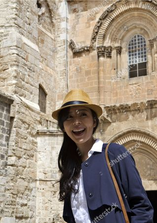Chinese Actress Zhang Jingchu Walks Outside the Church of the Holy Sepulchre During the Filming of 'Old Cinderella' in Jerusalem's Old City 18 April 2013 Israel Jerusalem