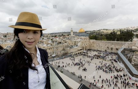 Chinese Actress Zhang Jingchu Poses For Photographs During the Filming of 'Old Cinderella' As She Attends a Press Conference Overlooking the Distinctive Golden Dome of the Rock and the Western Wall Judaism's Holiest Site in Jerusalem's Old City 18 April 2013 ' Israel Jerusalem