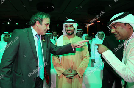 French Michel Platini (l) President of the Union of European Football Associations (uefa) Gestures with Secretary-general of the Uae National Olympic Committee (uae Noc) Mohammad Al Kamali (r) Next to H H Sheikh Majid Bin Mohammed Bin Rashid Al Maktoum (c) Chairman of Dubai Culture and Arts Authority During a Frist Session at the 7th Edition of the Dubai International Sports Conference in the Gulf Emirate of Dubai United Arab Emirates 28 December 2012 United Arab Emirates Dubai