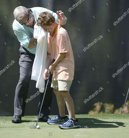 Fuzzy Zoeller of the Us Wipes the Brow of a Child He Brought out of the Gallery to Putt For Him During the Par 3 Contest After the Final Practice Round of the 2013 Masters Tournament at the Augusta National Golf Club in Augusta Georgia Usa 10 April 2013 the Masters Tournament Will Be Held 11 April Through 14 April 2013 United States Augusta