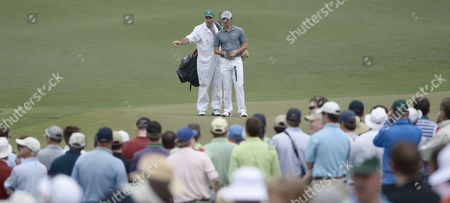Rory Mcilroy of Northern Ireland and His Caddie J P Fitzgerald Talk on the Green at the Second Hole During the Final Round of the 2013 Masters Tournament at the Augusta National Golf Club in Augusta Georgia Usa 14 April 2013 the Masters Tournament is Held 11 April Through 14 April 2013 United States Augusta