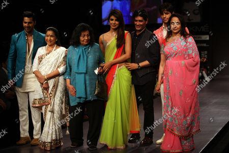 Bollywood Celebrities Varun Dhawan (l) Indian Legendary Playback Singer Asha Bhosle (2l) Veteran Costume Designer Bhanu Athaiya (3l) Priyanka Chopra (c) Manish Malhotra (3r) Sidharth Malhotra (2r) and Veteran Actress Hema Malini (r) Pose For Photograph Wearing Creations by Designer Manish Malhotra During the Lakme Fashion Week Summer/resort 2013 in Mumbai India 22 March 2013 Some 87 Designers Showcase Their Collections During Lfw Summer/resort 2013 India Mumbai