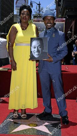 Stock Photo of Us Singer Alfonso 'Fonzi' Thorton (r) and Seveda Williams (l) the Niece of the Late Us Singer Luther Vandross Pose on a Star During a Ceremony Honoring Vandross Posthumously with a Star on the Hollywood Walk of Fame in Hollywood California Usa 03 June 2014 This is the 2 526th Star on the Hollywood Walk of Fame United States Hollywood
