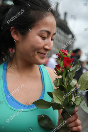 Stock Picture of Elizabeth Wang from San Francisco with her red roses