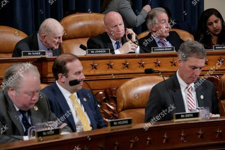 Sam Johnson, Kevin Brady, Richard Neal, George Holding, Jason T. Smith, Tom Rice House Ways and Means Committee member, back row, from left, Rep. Sam Johnson, R-Texas, Committee Chairman Rep. Kevin Brady, R-Texas, and the committee's ranking member, Rep. Richard Neal, D-Mass., begin a markup of the long-awaited plan by Republicans to repeal and replace the Affordable Care Act, on Capitol Hill in Washington. Bottom row, from left are, Rep. George Holding, R-N.C., Rep. Jason T. Smith, R-Mo., and Rep. Tom Rice, R-S.C