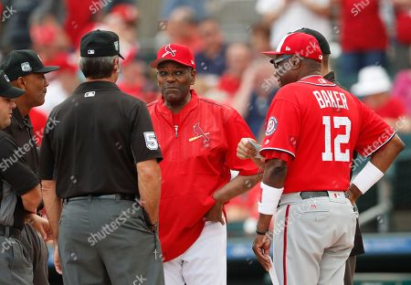 Bob Gibson, Dusty Baker Former St. Louis Cardinals pitcher and Baseball Hall of Fame member Bob Gibson, center, exchanges lineup cards with Washington Nationals manager Dusty Baker (12) before a spring training baseball game, in Jupiter, Fla