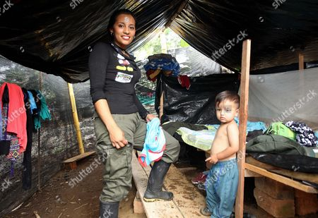 Guerrilla rebel Diana Sanchez from Revolutionary Armed Forces of Colombia (FARC), with her son in a camp site, in Tumaco, in Narino department, Colombia, 08 March 2017. Dozens of women guerrillas from FARC celebrate International Women's Day, for the first time after a peace treaty was signed. They hope to build a new political party and reunite with their families after decades of armed conflict.