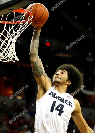 Utah State's Jalen Moore dunks during the second half of an NCAA college basketball game against San Jose State in the Mountain West Conference tournament, in Las Vegas. Utah State defeated San Jose State 90-64