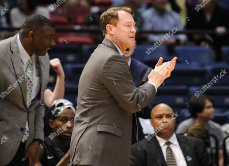 Charlotte 49ers head coach Mark Price encourages his team during the CUSA Tournament between the Charlotte 49ers and the UAB Blazers at Legacy Arena in Birmingham AL Steve Roberts /Cal Sport Media