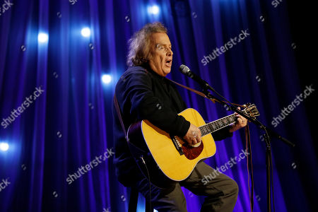 "Stock Photo of Don McLean performs during a taping of Dolly Parton's Smoky Mountain Rise Telethon in Nashville, Tenn. Court officials said Wednesday, March 8, 2017, that a Maine court has given the ex-wife of ""American Pie"" singer McLean an order of protection against him"