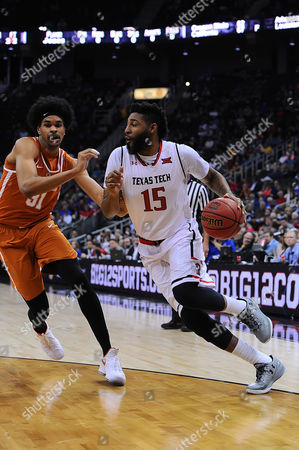 Stock Photo of Texas Tech Red Raiders forward Aaron Ross (15) takes Texas Longhorns forward Jarrett Allen (31) to the baseline during the NCAA Phillips 66 Big 12 Men's Basketball Championship game between the Texas Longhorns and the Texas Tech Red Raiders at the Sprint Center in Kansas City, Missouri