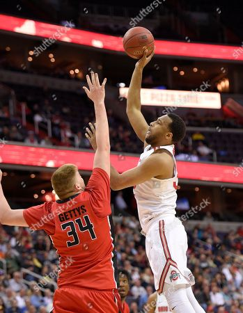 Stock Picture of Trevor Thompson, C.J. Gettys Ohio State center Trevor Thompson, right, shoots against Rutgers center C.J. Gettys (34) during the first half of an NCAA college basketball game in the Big Ten Conference tournament, in Washington