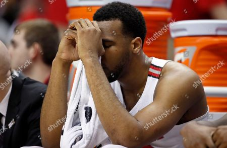 Ohio State center Trevor Thompson reacts on the bench during the second half of an NCAA college basketball game against Rutgers in the Big Ten tournament, in Washington. Rutgers won 66-57
