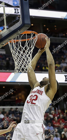 Ohio State Buckeyes C #32 Trevor Thompson tries to dunk during a Big 10 Men's Basketball Tournament game between the Rutgers Scarlet Knights and the Ohio State Buckeyes at the Verizon Center in Washington D.C. Rutgers defeats Ohio State, 66-57