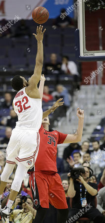 Stock Photo of Ohio State Buckeyes C #32 Trevor Thompson goes over Rutgers Scarlet Knights C #34 C.J. Gettys to the basket during a Big 10 Men's Basketball Tournament game between the Rutgers Scarlet Knights and the Ohio State Buckeyes at the Verizon Center in Washington D.C. Rutgers defeats Ohio State, 66-57